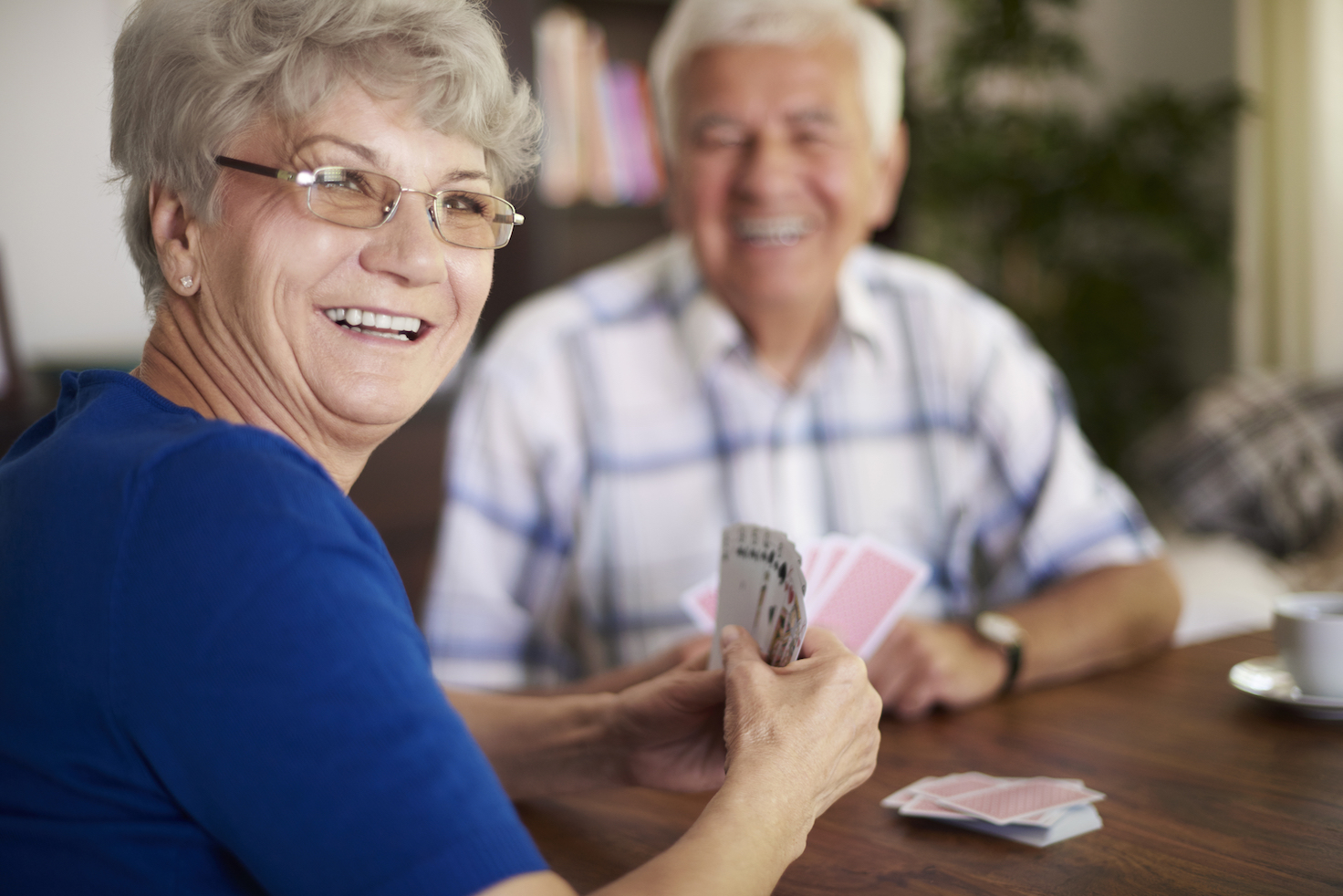 Elderly people playing cards.