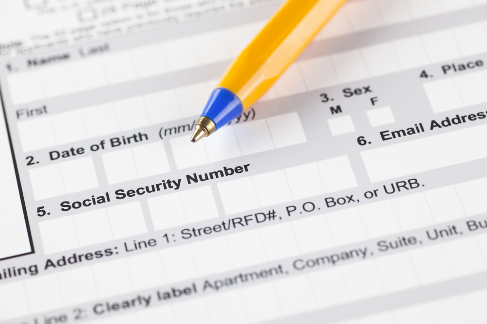 Application form with ballpoint pen. Focus on social security number's fields.