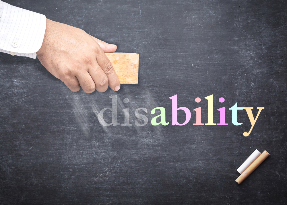 """People hand holding eraser for change word """"disability"""" to """"ability"""""""