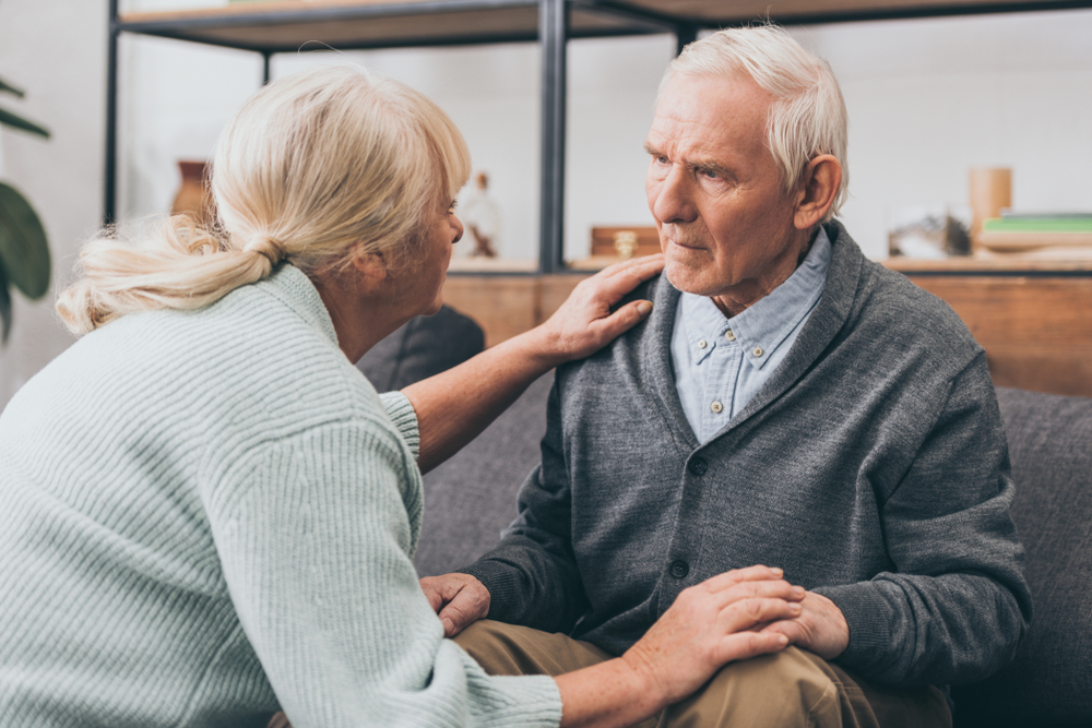 retired couple holding hands and looking at each other
